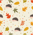 autumn leaf pattern with hedgehog vector image