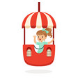 cute little girl riding a colorful carousel kid vector image vector image
