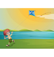 a young boy playing with his kite at riverbank vector image