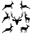 set of black silhouettes of reindeers in vector image