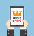 hands holding tablet with words content is king vector image vector image