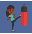 Woman exercising with punching bag vector image vector image
