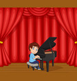 cartoon boy performing piano on stage vector image