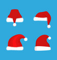 red santa claus hats set christmas vector image vector image
