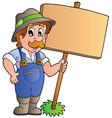 cartoon farmer holding wooden board vector image