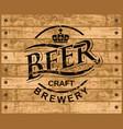 emblem for craft beer on a wooden background vector image