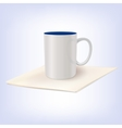 white ceramic cup standing on a napkin vector image