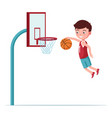 Boy basketball player jumps with ball