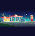 gas station with oil pump and market at night vector image