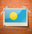 Flags Palau scotch taped to a red brick wall vector image