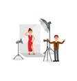 female model wearing red dress in photo studio vector image