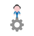 businessman character standing on gear vector image vector image