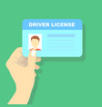hand holding car driving licence id card vector image