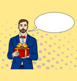 man holds big gift box in retro comic pop vector image vector image