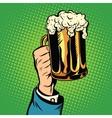 beer mug in hand pop art retro vector image
