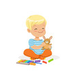 ute little boy playing with plasticine kids vector image