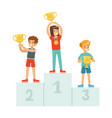 happy children standing on the winner podium with vector image
