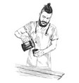 young barista man in apron with a beard holds vector image vector image
