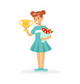 happy school girl holding winner cup and bouquet vector image vector image