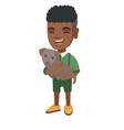 african-american happy boy holding a dog vector image vector image