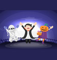 kids dressed in halloween costume jumping and vector image