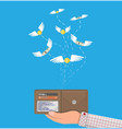 coin and dollar bill flying over hand with wallet vector image vector image
