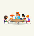 redhead female teacher showing picture to children vector image vector image