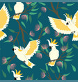 seamless pattern with cockatoo and flowers vector image