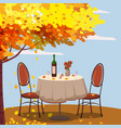 autumn cafe table with wine for two persons autumn vector image vector image