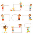 smiling kids standing with white blank boards set vector image vector image