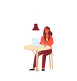 woman with laptop and coffee sitting at the table vector image