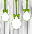 Easter three papers eggs wrapping green bows on vector image vector image