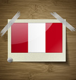 Flags Peru at frame on wooden texture vector image vector image