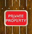 PRIVATE PROPERTY sign hanging on a wooden fence vector image vector image