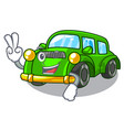 two finger miniature classic car in shape vector image