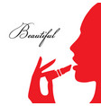 woman paints her lips vector image