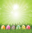 easter eggs in grass 2402 vector image vector image