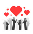 hands up with hearts like volunteers charity vector image