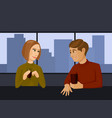 young couple talking and drinking in a cafe vector image