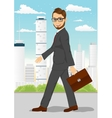 businessman walking through the city vector image vector image