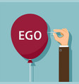 hand uses a needle to burst a balloon with ego vector image