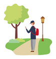 young man standing in the park activity vector image vector image