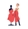 fashion designer and tailor holding red dress vector image