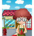 A boy holding a gift in front of the flower shop vector image vector image