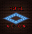 neon signboard hotel sign on a brick wall vector image vector image