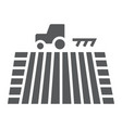 tractor on field glyph icon farming vector image
