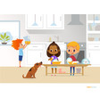 children cleaning up kitchen two multiracial kids vector image vector image