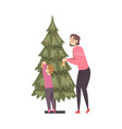 mom and son decorating christmas tree family vector image vector image