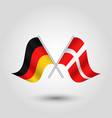 two crossed german and danish flags vector image vector image