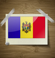 Flags Moldova at frame on wooden texture vector image vector image